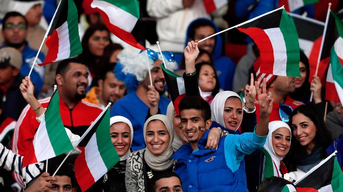 Fans of Kuwait cheer on their team during their Gulf Cup Tournament soccer match against Saudi Arabia at Isa Sports City in Isa Town January 12, 2013. REUTERS