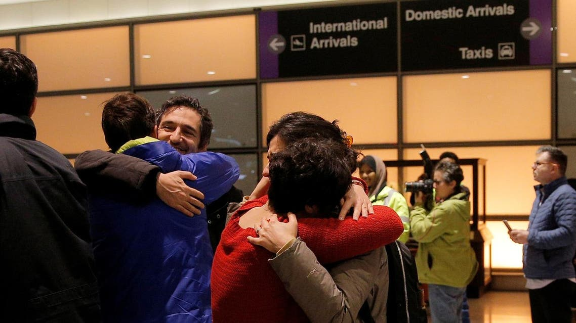 Mazdak Tootkaboni (2nd L) is reunited with friends and family after he was separated from other passengers and questioned as a result of U.S. Donald Trump's executive order travel ban, at Logan Airport in Boston, Massachusetts, U.S. January 28, 2017. Tootkaboni, an Iranian with a U.S. green card, is a professor at the University of Massachusetts Dartmouth (UMASS). REUTERS