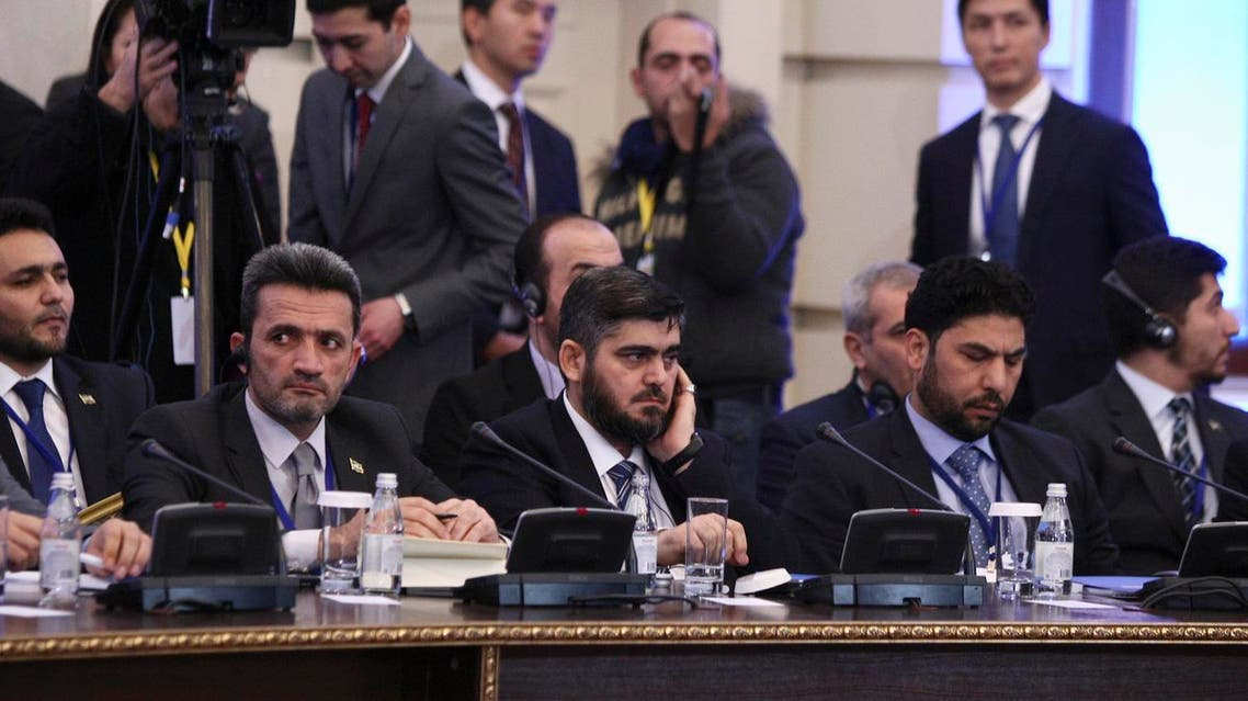 Mohammad Alloush (C), the head of the Syrian opposition delegation, attends Syria peace talks in Astana, Kazakhstan January 23, 2017. REUTERS