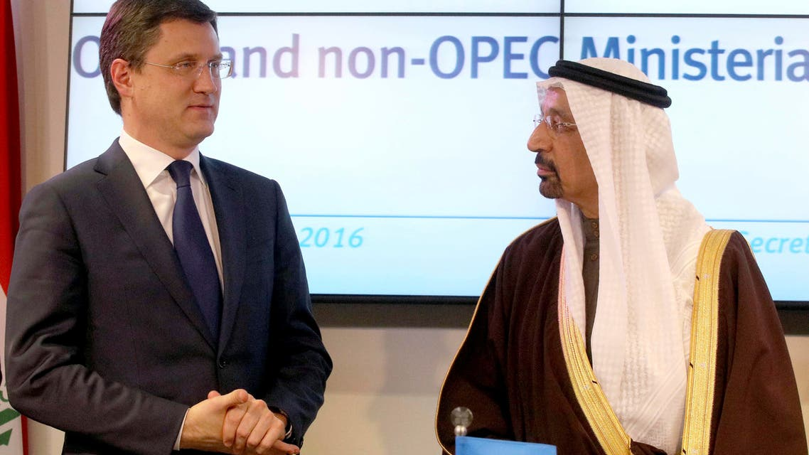 Russian Minister of Energy Alexander Novak (left), and Khalid al-Falih, Minister of Energy, Industry and Mineral Resources of Saudi Arabia finish a news conference after a meeting of OPEC, in Vienna, Austria, on Dec. 10, 2016. (AP)