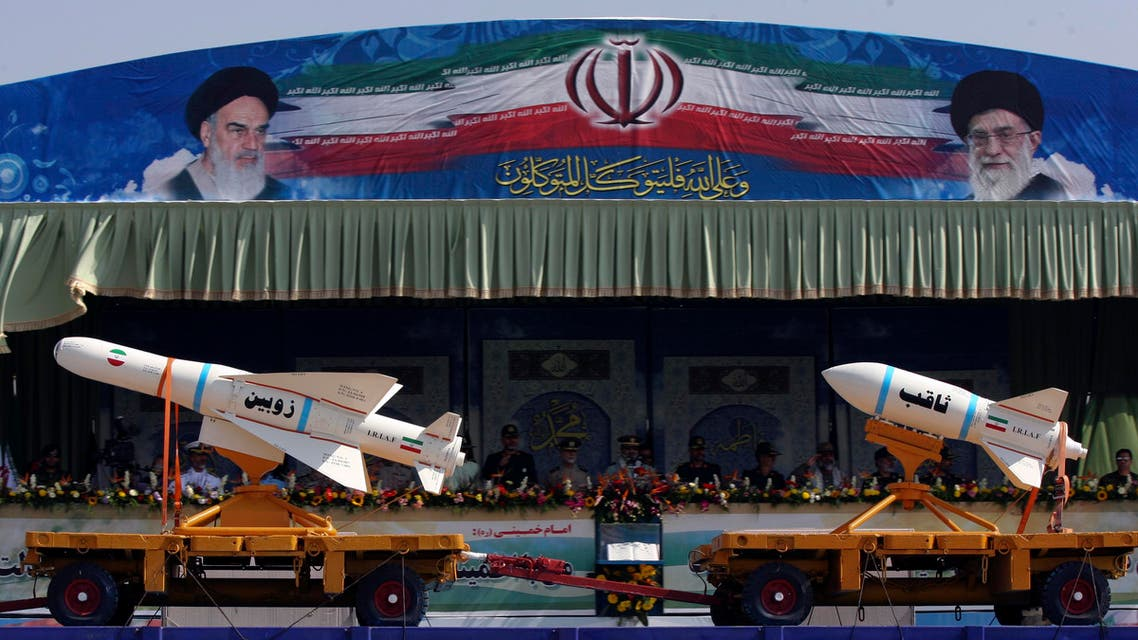 A military vehicle carrying Iranian Zoobin smart bomb (L) and Sagheb missile under pictures of Iran's Supreme Leader Ayatollah Ali Khamenei (R) and Late Leader Ayatollah Ruhollah Khomeini during a parade to commemorate the anniversary of the Iran-Iraq war (1980-88), in Tehran September 22, 2011. REUTERS/Stringer (IRAN - Tags: POLITICS MILITARY ANNIVERSARY)