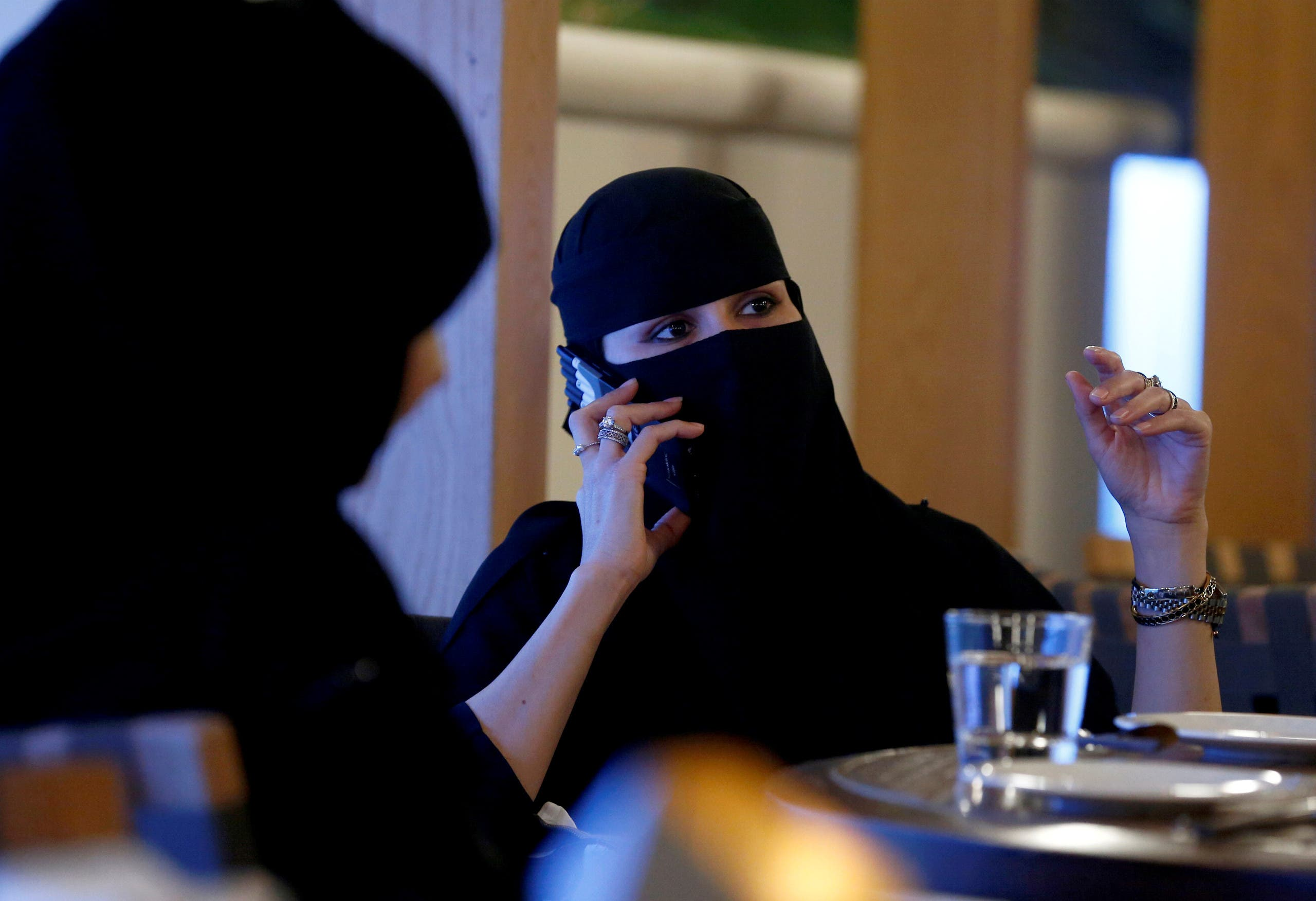 A woman speaks on a mobile phone in a cafe in Riyadh, Saudi Arabia October 6, 2016. (Reuters)