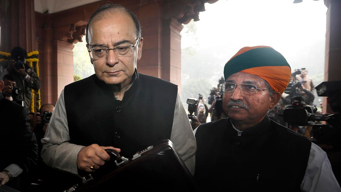 Indian Finance Minister Arun Jaitley (left), with junior finance minister Arjun Ram Meghwal, arrive to present federal budget at the Parliament house in New Delhi on Feb. 1, 2017. (AP)