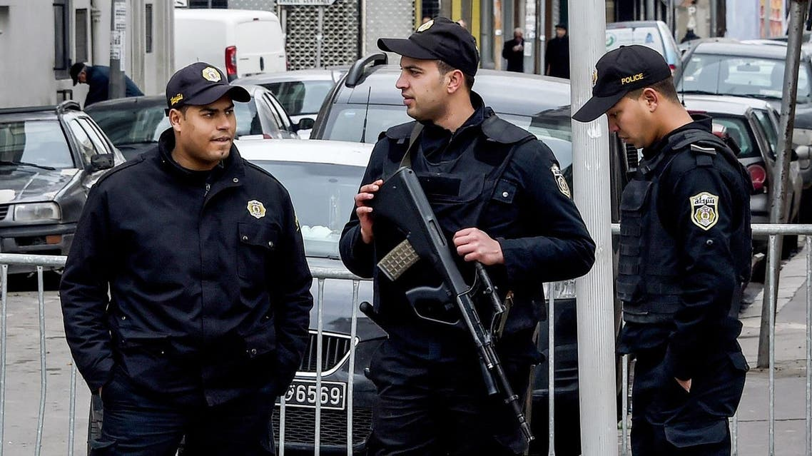 Tunisian police stand guard at a roadblock near a rally on January 14, 2017 in the Habib Bourguiba Avenue in the capital Tunis marking the sixth anniversary of the 2011 revolution. (AFP)