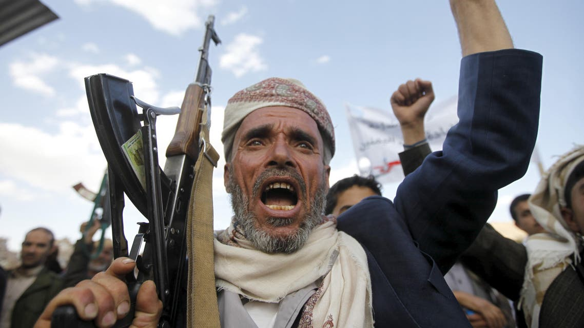 A follower of the Houthi shouts slogans as he raises his weapon during a rally against U.S. support to Saudi-led air strikes, in Yemen's capital Sanaa, March 1, 2016. reuters