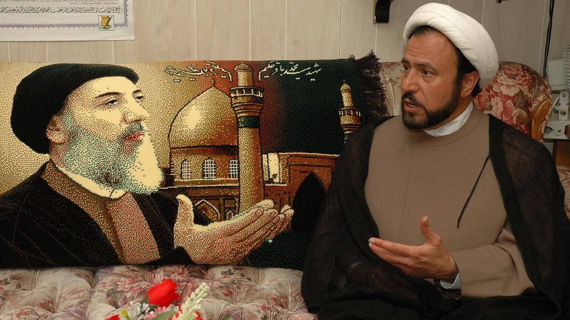 This file photo shows Director of the Karbalaa Islamic Educational Center, Imam Husham Al-Husainy, speaking about the impending execution of Saddam Hussein in Dearborn, Mich., on Dec. 29, 2006. (AP)
