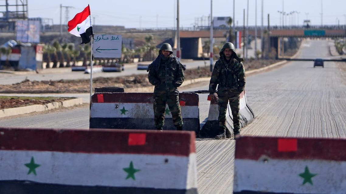 Syrian army soldiers man a checkpoint along a road in Aleppo, Syria February 1, 2017. REUTERS