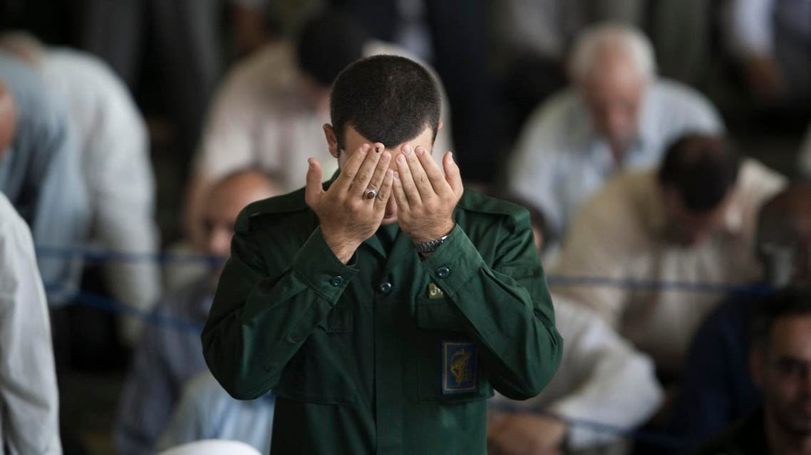 A member of Iran's Revolutionary Guard prays during Friday prayers at the University of Tehran mosque July 16, 2010. (AP)