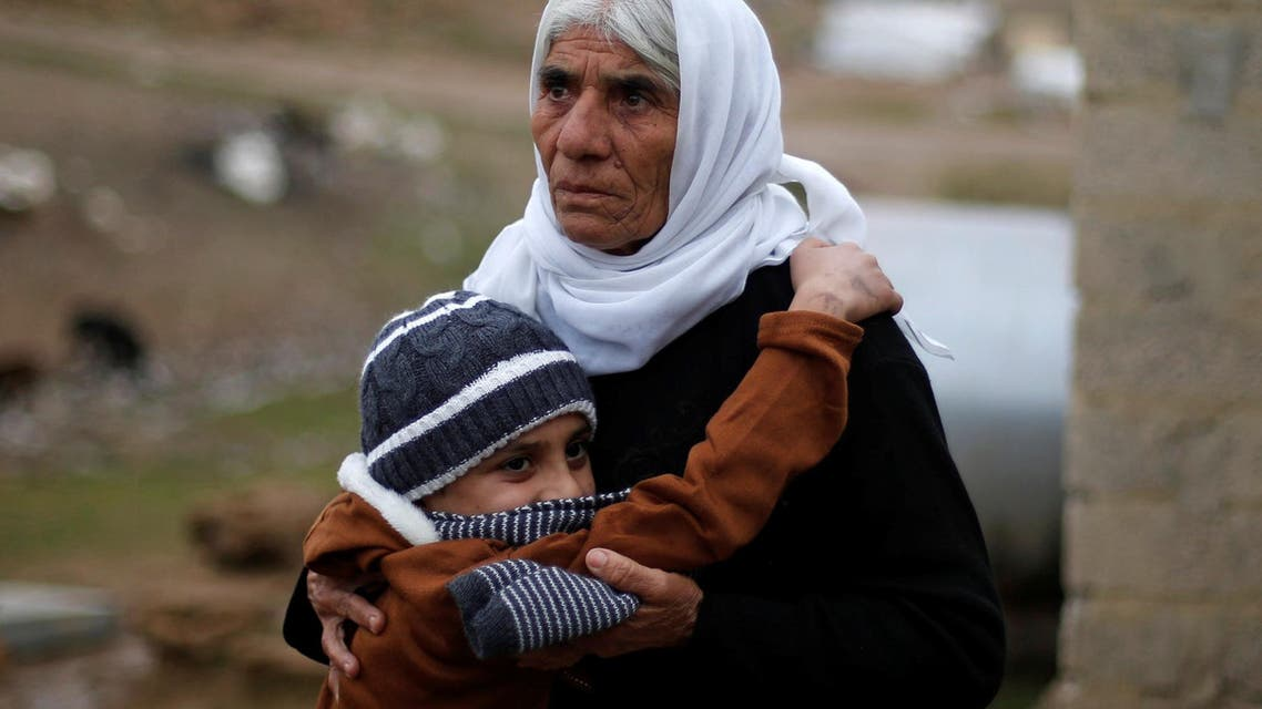 Ayman, a boy from a minority Yazidi community, who was sold by Islamic State militants to a Muslim couple in Mosul, hugs his grandmother after he was returned to his Yazidi family, in Duhok, Iraq, January 31, 2017. AP