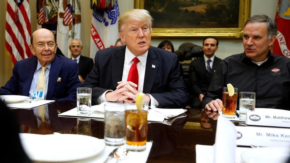 U.S. President Donald Trump and his Commerce Secretary nominee Wilbur Ross (L) meet with representatives of Harley-Davidson, including CEO Matthew Levatich (R), at the White House in Washington, U.S. February 2, 2017. REUTERS