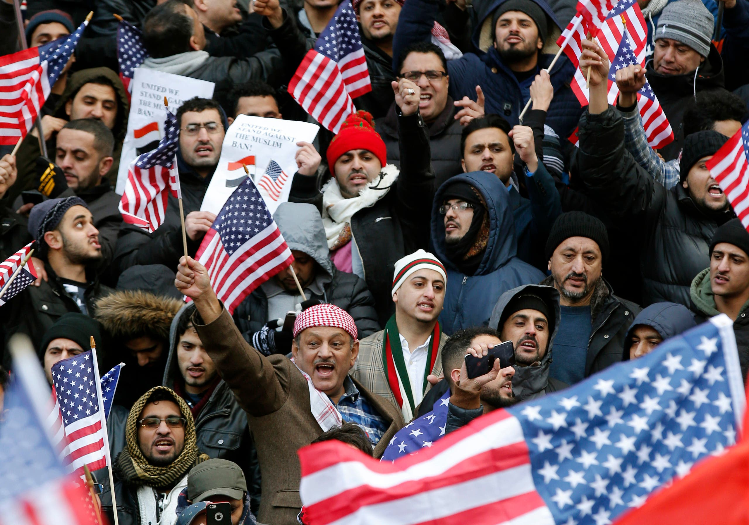 Muslims and Yemenis gather with their supporters on the steps of Brooklyn's Borough Hall, during a protest against President Donald Trump's temporary ban on Muslims from certain countries entering the United States, Thursday, Feb. 2, 2017, in the Brooklyn borough of New York. (AP)