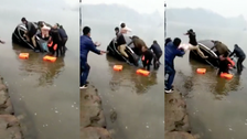 VIDEO: Man throws infant to stranger on dry land, as car sinks