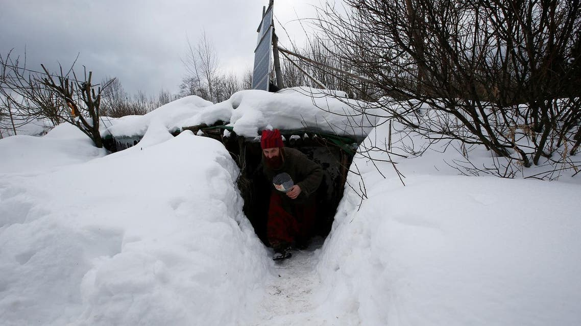 """Yury Alekseyev, a former lawyer from Moscow who is called a """"Russian hobbit"""", leaves his underground home in the forest on the side of the road northeast from Moscow, Russia February 3, 2017. REUTERS"""