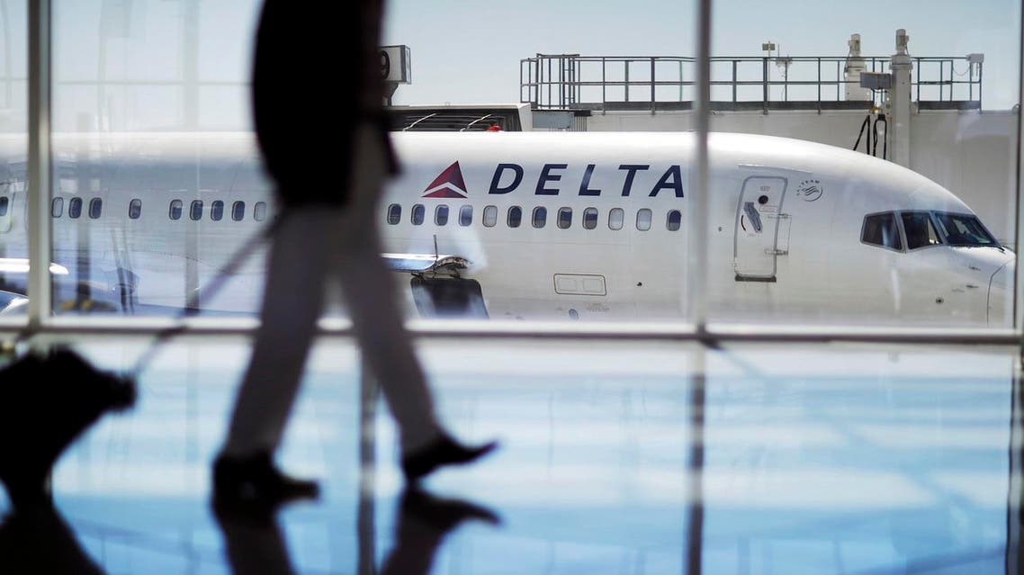 In this Thursday, Oct. 13, 2016, photo, a Delta Air Lines jet sits at a gate at Hartsfield-Jackson Atlanta International Airport in Atlanta. Delta announced Thursday, Dec. 8, 2016, that the airline is rolling out new free snacks for customers in the main cabin, including brand-name yogurt bars and pretzels. Some will come in larger portions than before because, Delta has figured out, that's what customers crave. (AP