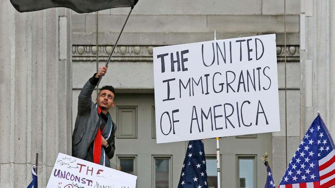 A man waves a Yemeni flag as he and other members of the Yemeni community were joined by a huge crowd of supporters during a protest on the steps of Brooklyn's Borough Hall as they express their opposition to President Donald Trump's temporary travel ban on citizens from seven predominantly Muslim countries, Thursday, Feb. 2, 2017, in the Brooklyn borough of New York. ap