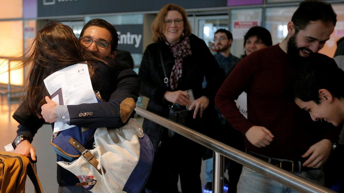 Behnam Partopour, a Worcester Polytechnic Institute student from Iran, is greeted by his sister Bahar at Logan Airport after he cleared U.S. customs and immigration on an F1 student visa in Boston. (Reuters)