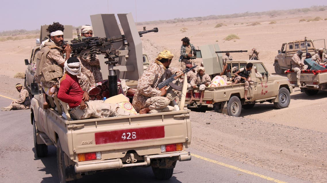 Members of the Yemeni army ride on the back of military trucks near the Red Sea coast city of al-Mokha, Yemen January 23, 2017