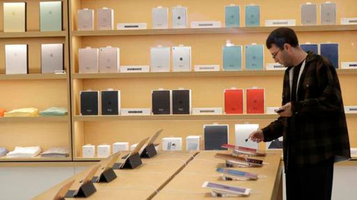 A man looks at iPad tablets displayed at a store on Apple's campus before an announcement of new products Thursday, Oct. 27, 2016, in Cupertino, California. (AP)