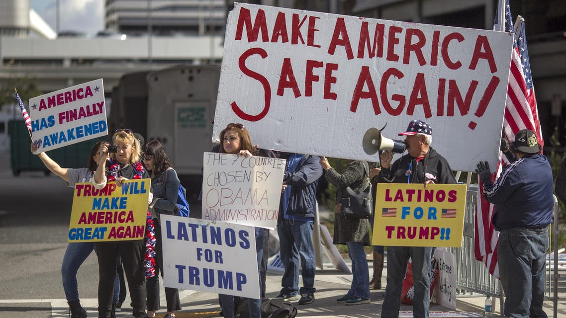 LOS ANGELES, CA - FEBRUARY 04: Trump supporters demonstrate against a ruling by a federal judge in Seattle that grants a nationwide temporary restraining order against the presidential order to ban travel to the United States from seven Muslim-majority countries, at Tom Bradley International Terminal at Los Angeles