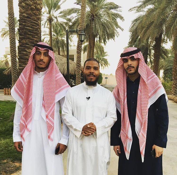 Mutah Beale with his business partners in Saudi Arabia. (Supplied)