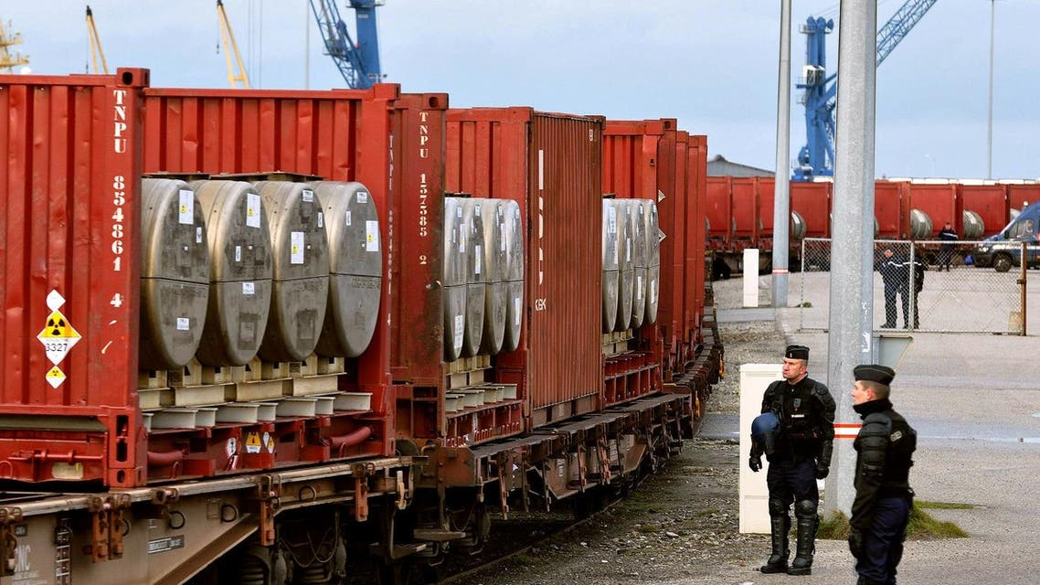 Police officers look at a train carrying uranium to be loaded on a cargo ship for Russia on January 25, 2010 in Cherbourg, western France.