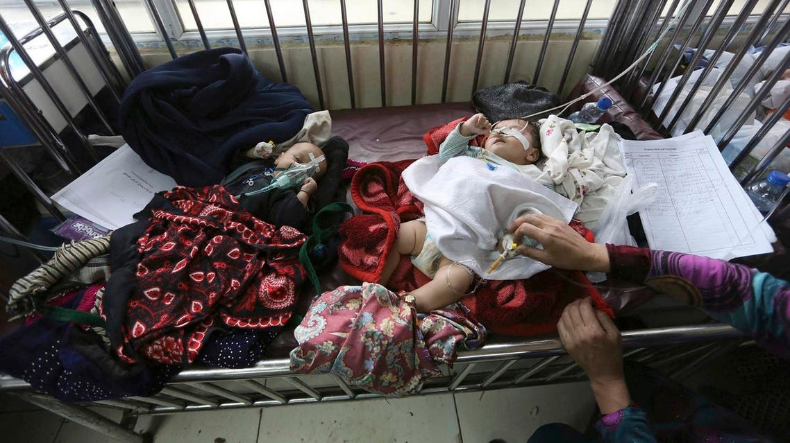 Afghan children receive treatment at a pediatric hospital, in Kabul, Afghanistan, Monday, Jan. 2, 2017. (AP Photo/Rahmat Gul)