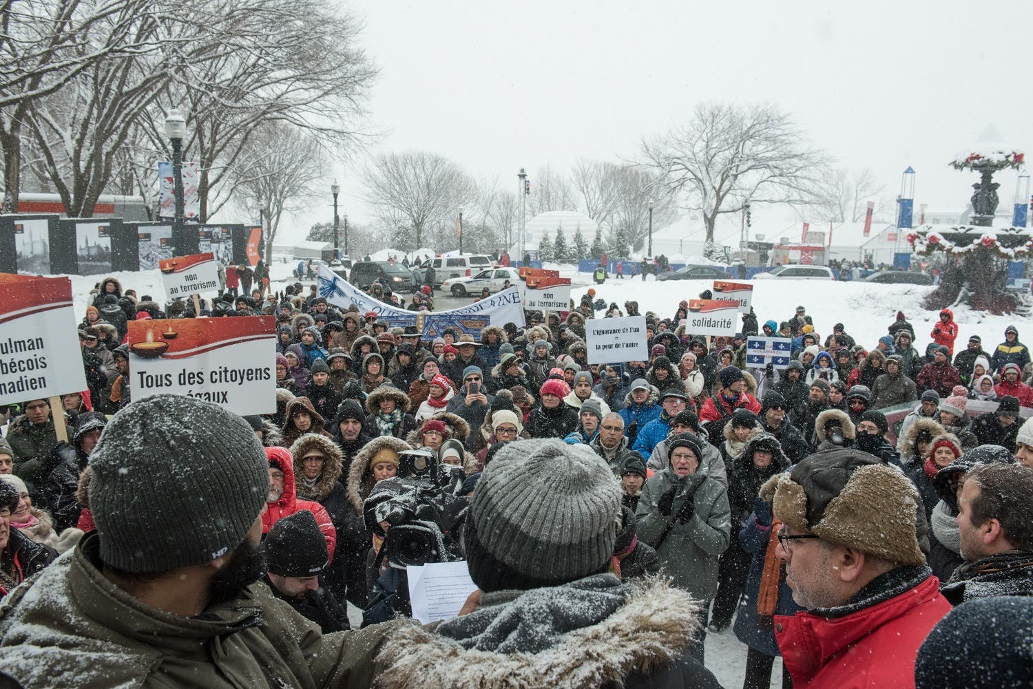 Several hundred people march in solidarity for the victims of the mosque shooting in Quebec City, on February 5, 2017. (AFP)