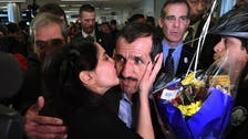 Travelers arrive in US to hugs and tears after ban is lifted