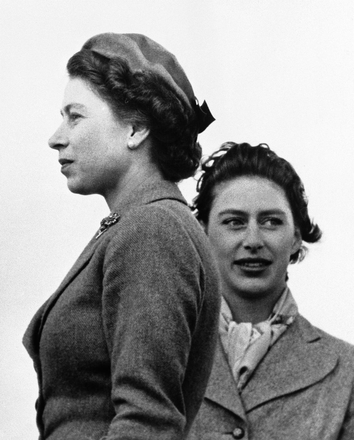 This is a April 30, 1955 photo of Britain's Queen Elizabeth II and Princess Margaret, right, as they attend the West Norfolk hunt point-to-point races at Sporle, England. Princess Margaret four years younger than the queen, Margaret was Elizabeth's only sister (Photo: AP)