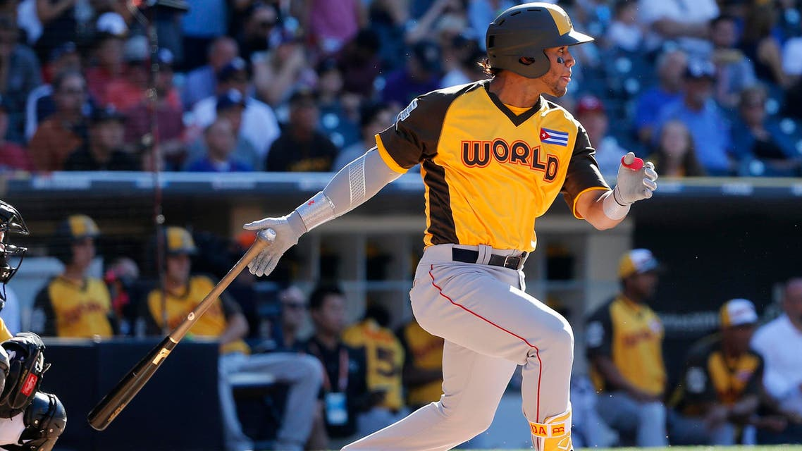In this July 10, 2016, file photo, World team's Cuban infielder, Yoan Moncada, of the Boston Red Sox, hits against the US team during the All-Star Futures baseball game in San Diego. AP