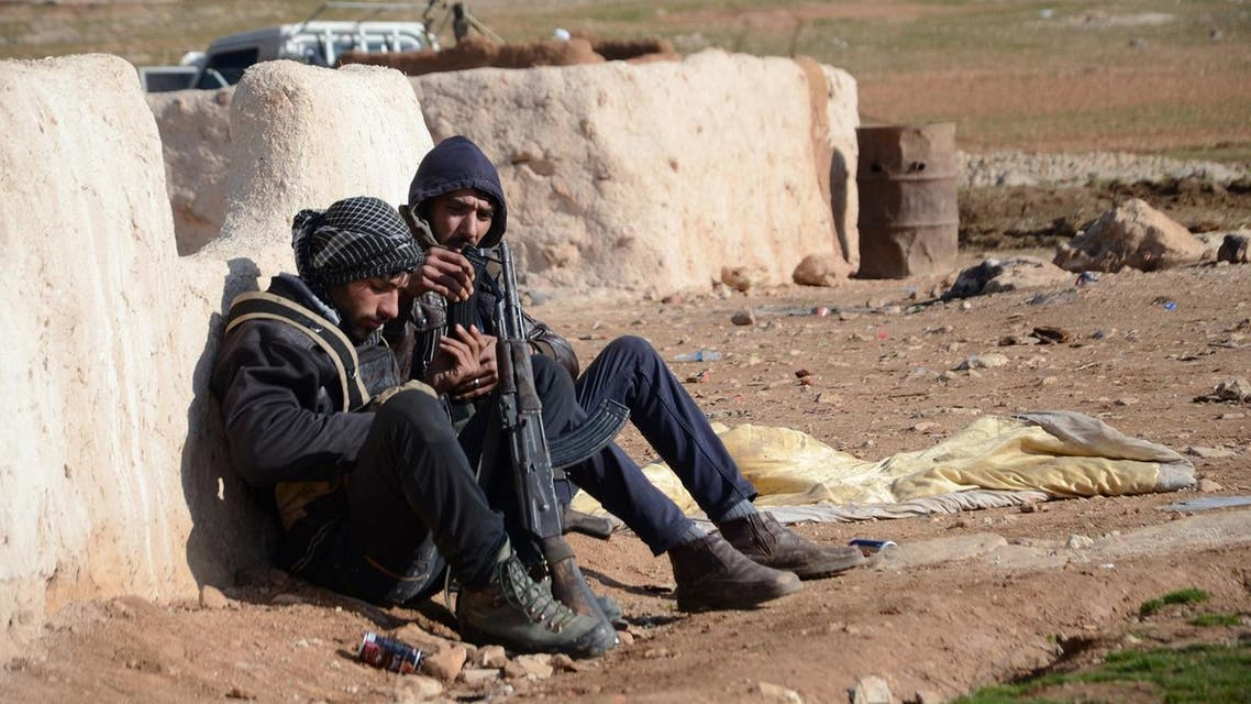Fighters from the Free Syrian Army take a break during battles against ISIS militants near the town of Qabasin, some 30 km from Aleppo, on January 8, 2017. (AFP)