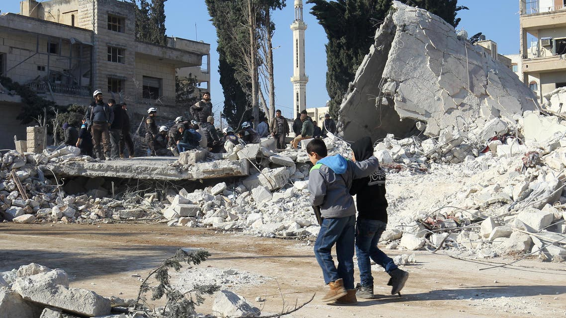 Boys walk at a site hit by airstrikes in the rebel-held city of Idlib, Syria February 7, 2017. REUTERS/Ammar Abdullah