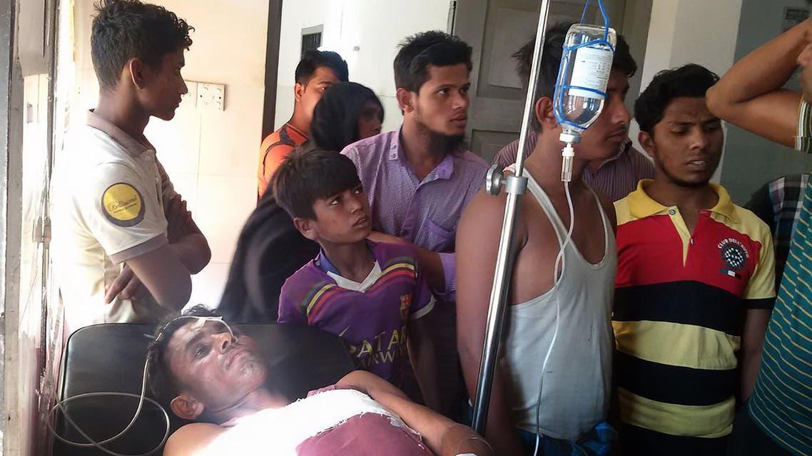 An injured Bangladeshi fisherman is treated in a hospital in Teknaf on February 6, 2017.AFP