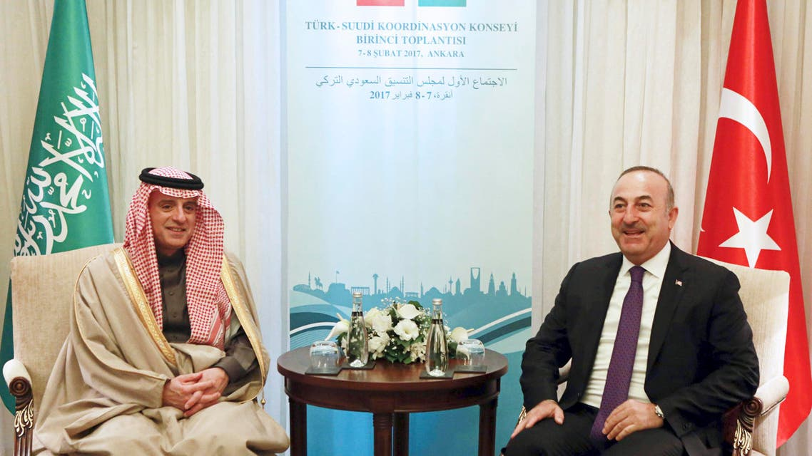 Turkish Foreign Minister Mevlut Cavusoglu (R) and Foreign Minister of Saudi Arabia Adel Al Jubeir (L) react during a meeting in Ankara, on February 8, 2017. AFP