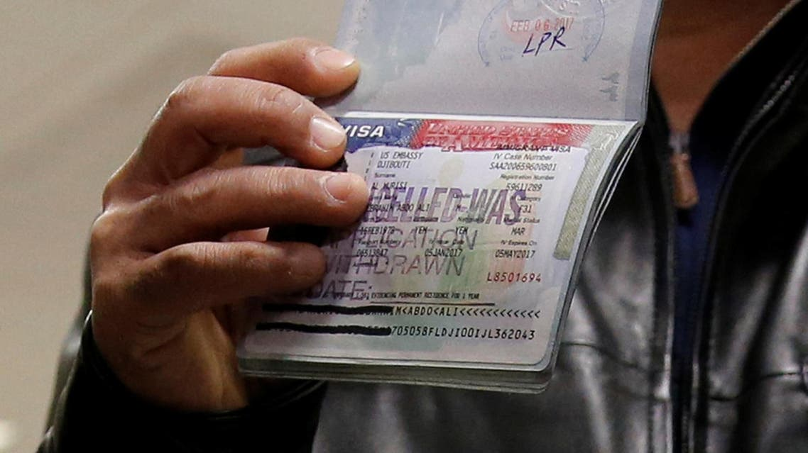 A member of the Al Murisi family, Yemeni nationals who were denied entry into the U.S. last week because of the recent travel ban, shows the cancelled visa in their passport. (Reuters)