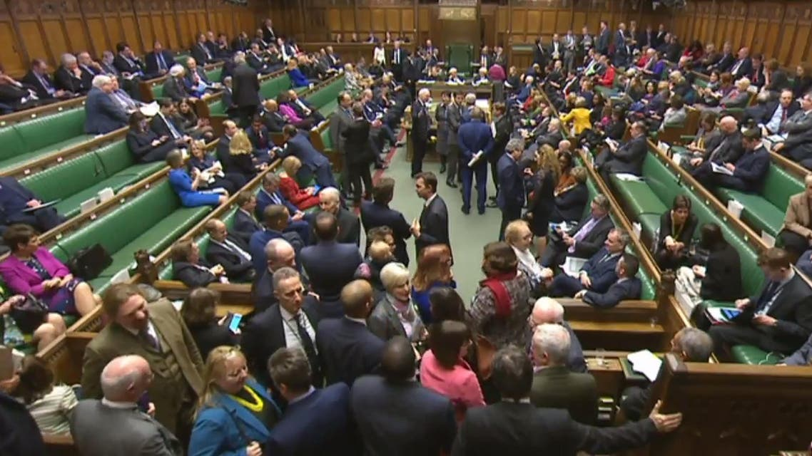 In a still image taken from footage broadcast by the UK Parliamentary Recording Unit (PRU) on February 8, 2017 members of parliament filter back into the House of Commons from the lobby during the process of voting on proposed ammendments to the Article 50 Withdrawl from the European Union Bill in central London on February 8, 2017