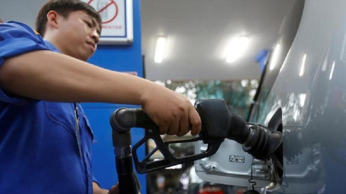 An employee pumps petrol into a car at a petrol station in Hanoi, Vietnam December 20, 2016. REUTERS