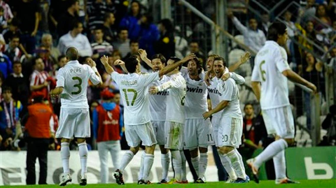 Real Madrid players celebrate after winning the Spanish La Liga league title at the end of the Spanish La Liga match against Athletic Bilbao's on Wednesday May 2, 2012. (AP)