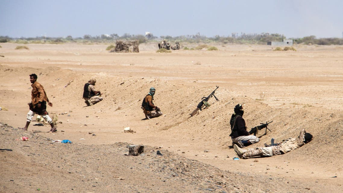 Yemeni government forces take positions and rest on the side of a road on the road leading to the southwestern port of Mokha after they recaptured the town from Shiite Huthi rebels on January 23, 2017. (AFP)