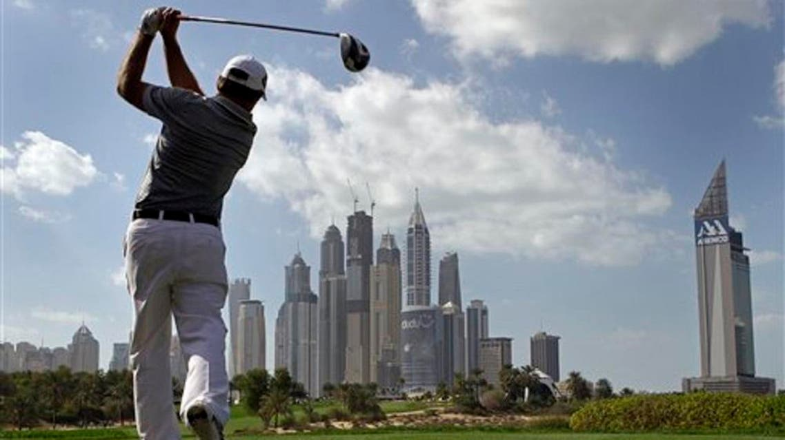 Richard Sterne from South Africa tees off on the 8th hole during final round of the Dubai Desert Classic Golf tournament in Dubai, on Feb. 3, 2013. (AP)