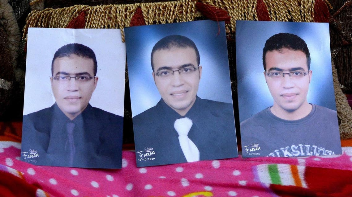 Portraits of Abdallah El-Hamahmy, the Egyptian suspected of being the machete attacker in Paris's Louvre museum, placed on a sofa at the family home in the Nile delta city of Mansura (Photo: Mahmood Shahiin/AFP)