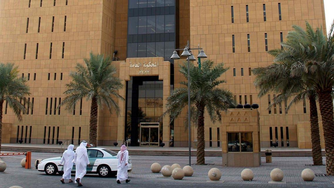 Saudi people seen near the entrance to the Riyadh general court in Riyadh, Saudi Arabia, Tuesday, Oct. 21, 2008.  AP