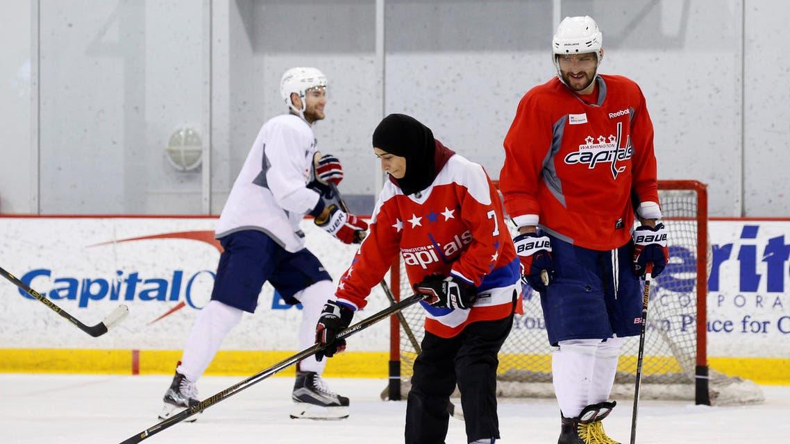 Washington Capitals hockey star Alex Ovechkin smiles as Fatima Al Ali from United Arab Emirates skates with the team in Arlington, Virginia, U.S. February 8, 2017.AFP