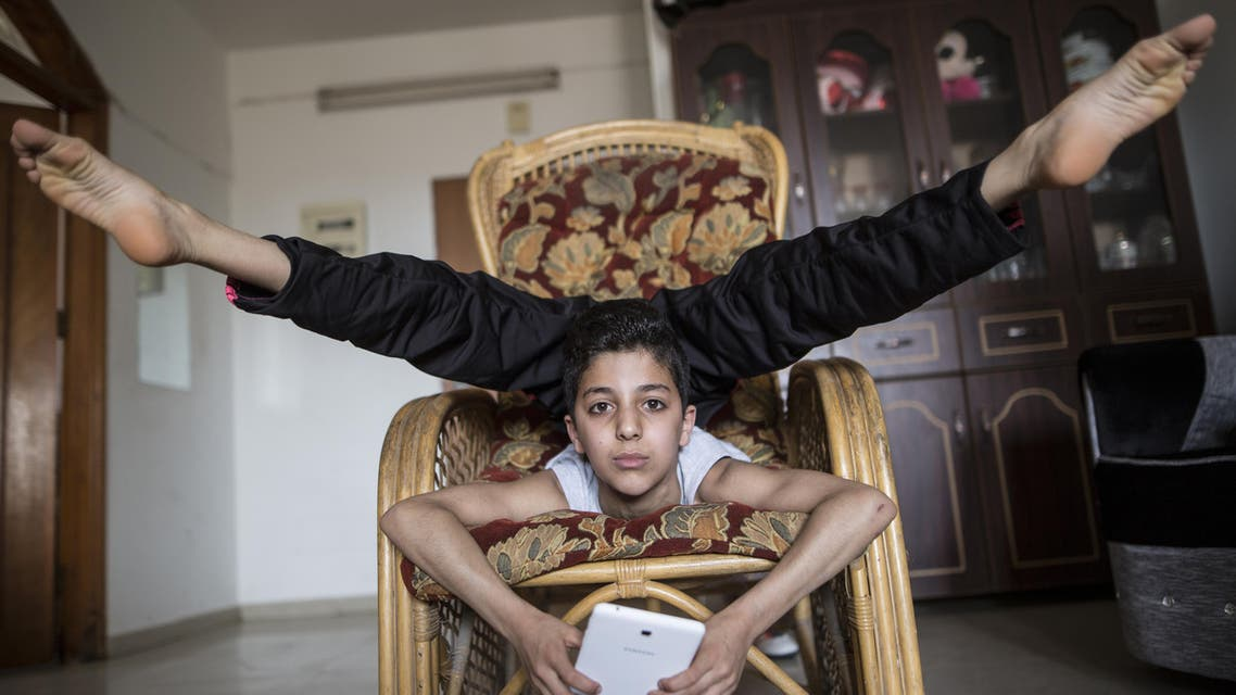 This file photo taken on April 28, 2016 shows then-twelve-year-old Palestinian teenager Mohammed al-Sheikh showing off his skills at his home in Gaza city. AFP