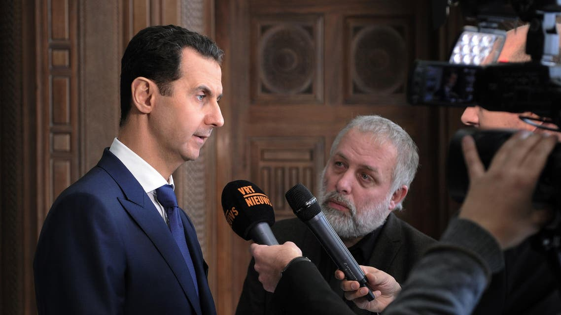 A handout picture released by the official Syrian Arab News Agency (SANA) on February 7, 2017 shows Syrian President Bashar al-Assad (L) giving an interview to a Belgian media outlet.