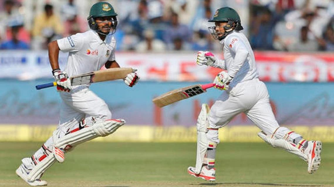 Bangladesh's captain Mushfiqur Rahim (right), and Mehedi Hasan run between the wickets during the third day of the cricket test match against India in Hyderabad, India, on Saturday, Feb. 11, 2017. (AP)