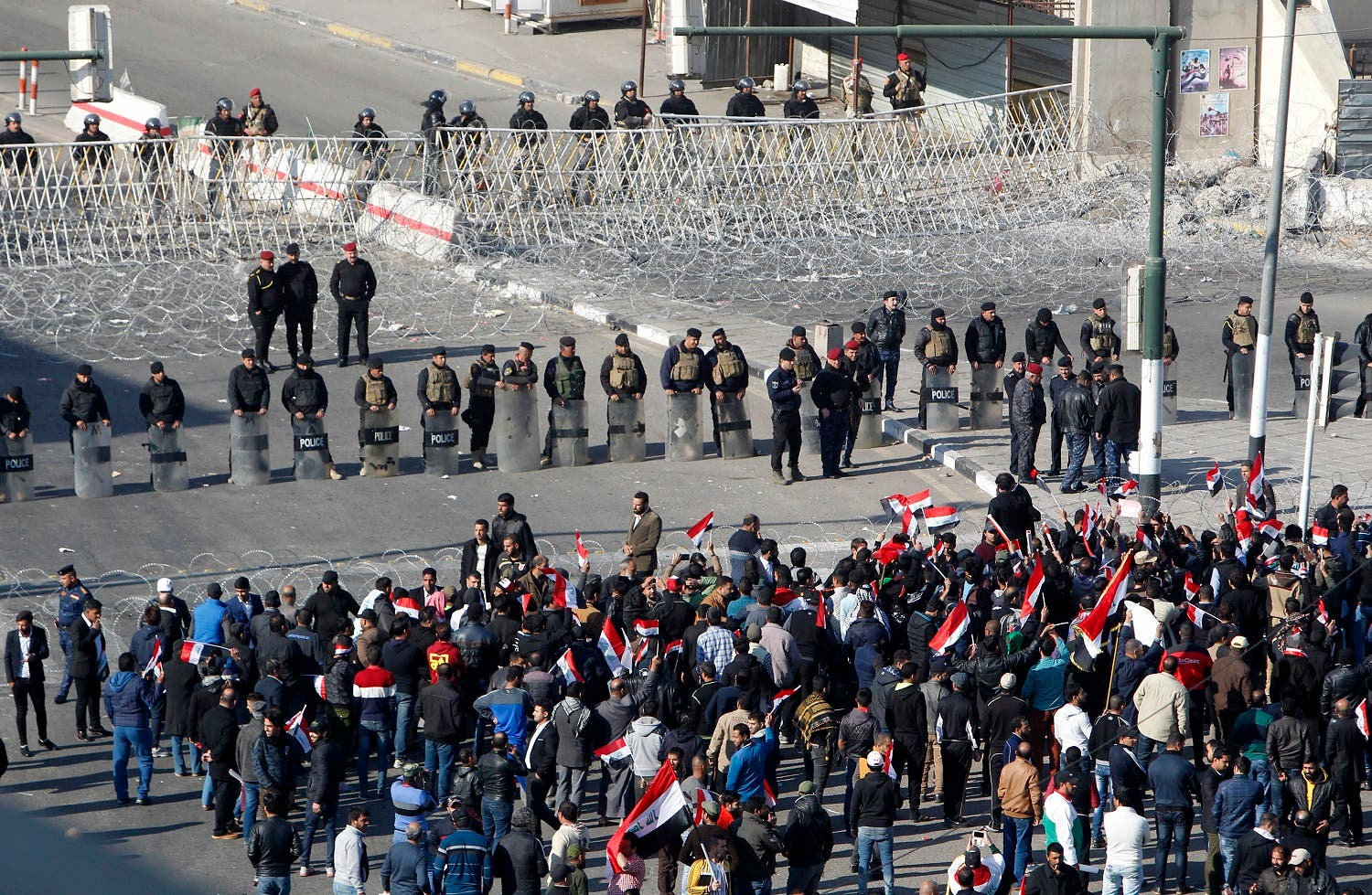 Iraqi security forces stand guard as supporters of the Sadrist movement gather during a demonstration in Baghdad. (AFP)