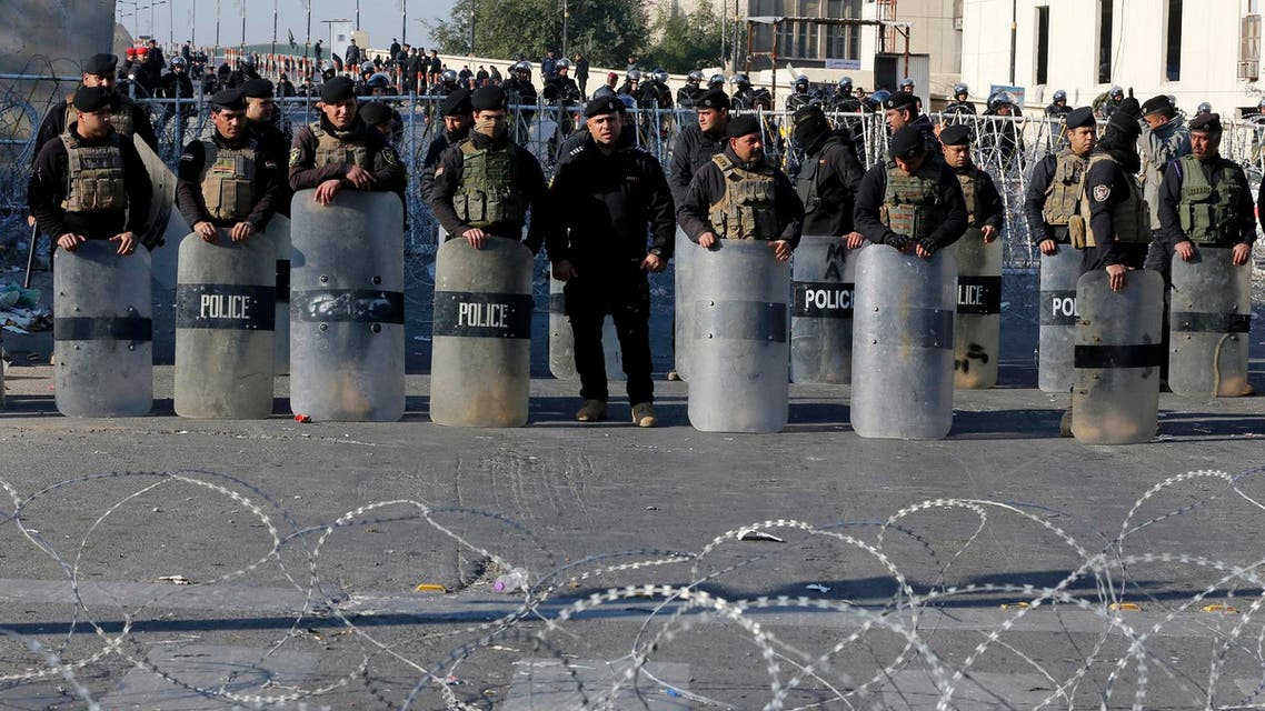 Iraqi riot police close a bridge leading to the heavily guarded Green Zone during a demonstration of followers of Iraq's influential cleric Muqtada al-Sadr in Baghdad, Iraq, Saturday, Feb. 11, 2017. (AP)