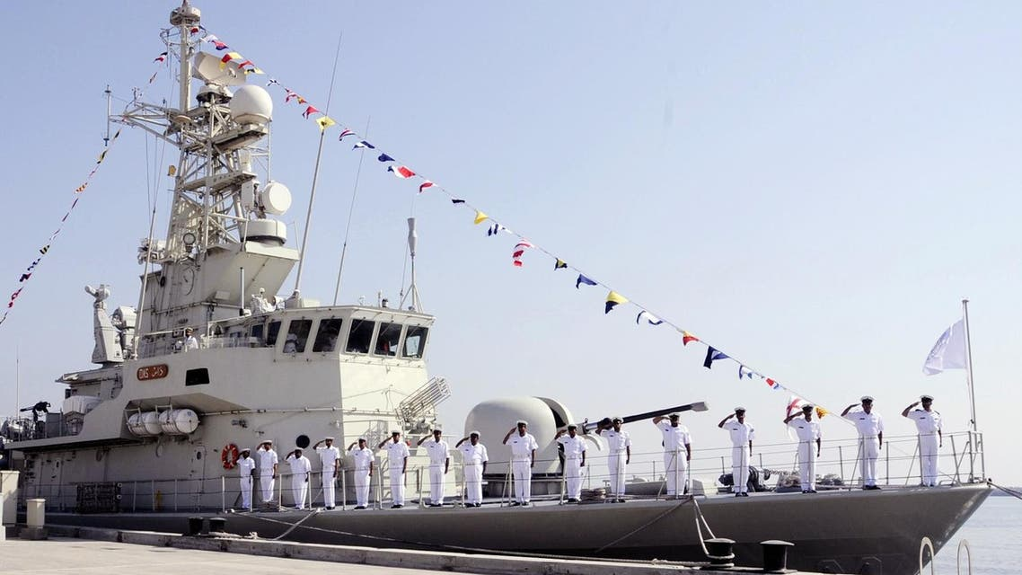 A handout photograph made available by the official Emirati News Agency, WAM, shows sailors saluting as they stand on the deck of a navy vessel in the emirate of Fujairah, as the United Arab Emirates opens a naval base on its east coast that would allow it to bypass the Strait of Hormuz if Iran were ever to close the strategic waterway, local media reported on October 21, 2010. Almost all oil exports from OPEC's fourth-largest producer now go through Gulf waters and pass the narrow strait, which separates the emirates from Iran, before reaching the Arabian Sea and the Indian Ocean. AFP PHOTO/HO =RECTRICTED TO EDITORIAL USE= HO / WAM / AFP