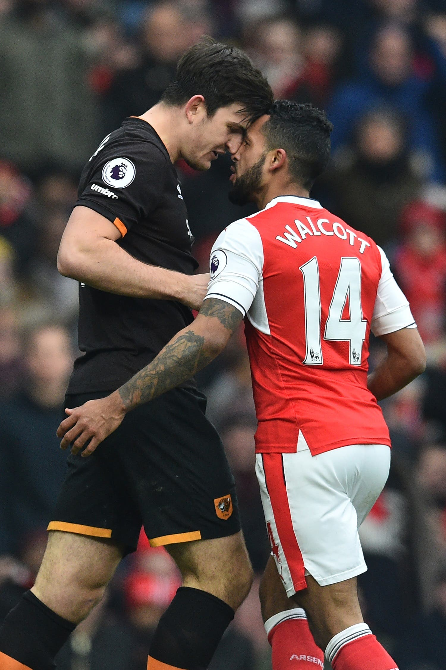Theo Walcott (R) and Harry Maguire (L) AFP.